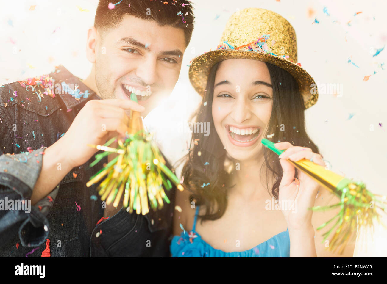 Young couple celebrating New Year's Eve - Stock Image