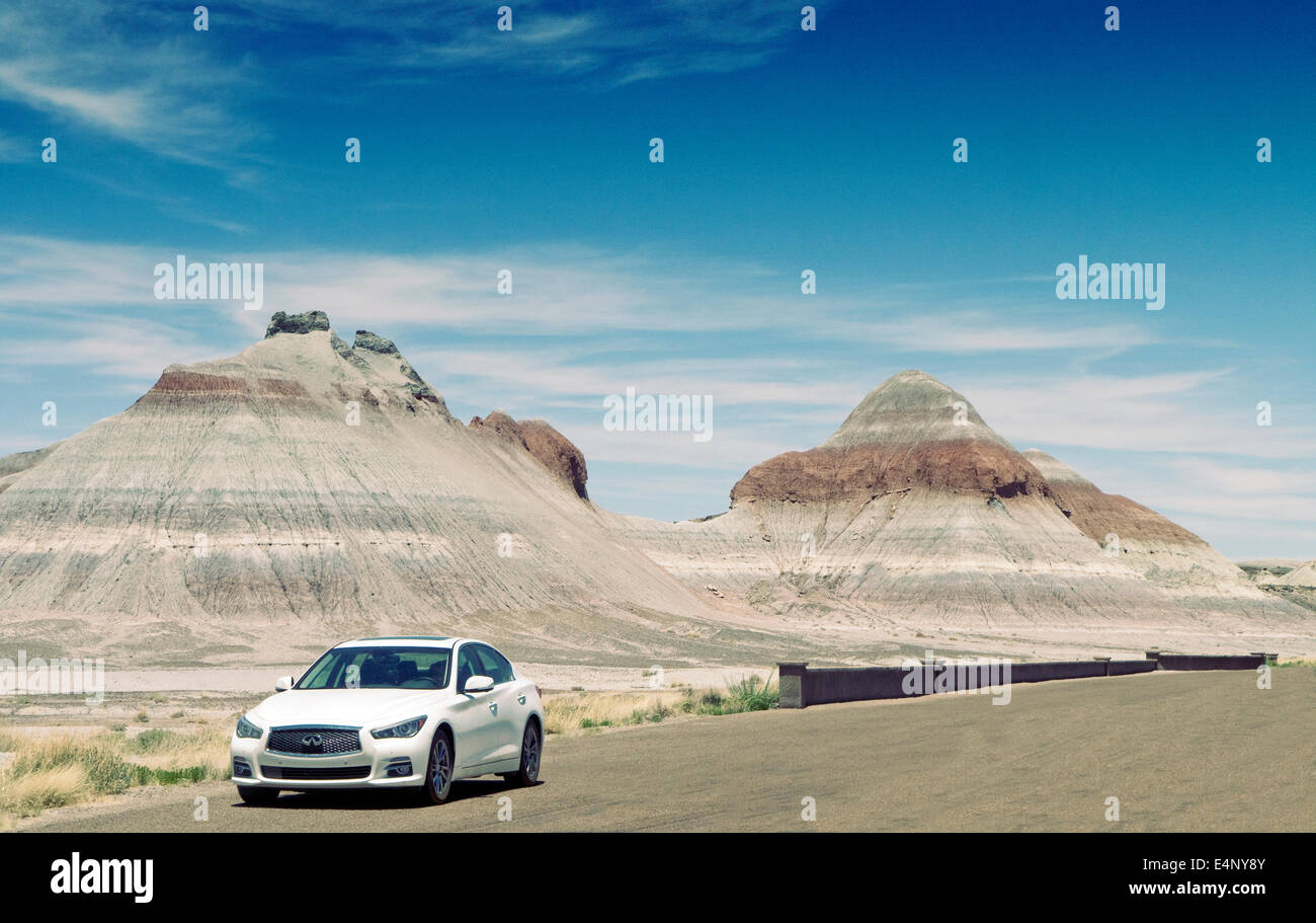 Infiniti Q50 in the Petrified Forest National Park Arizona USA.The Tepee's rock formation - Stock Image