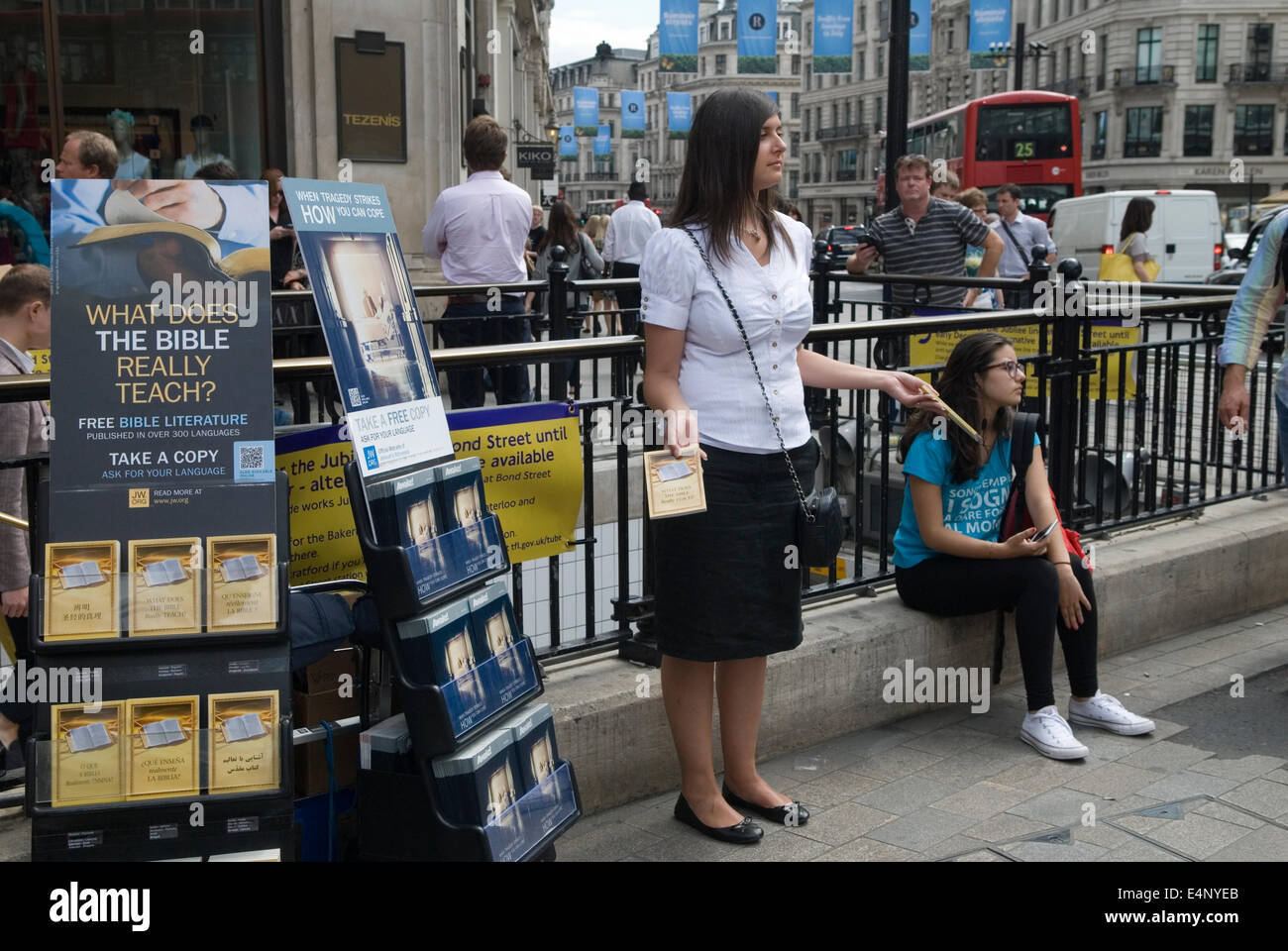 Awake and What Does the Bible Really Teach Jehovah's Witnesses literature being handed out in Oxford Street - Stock Image