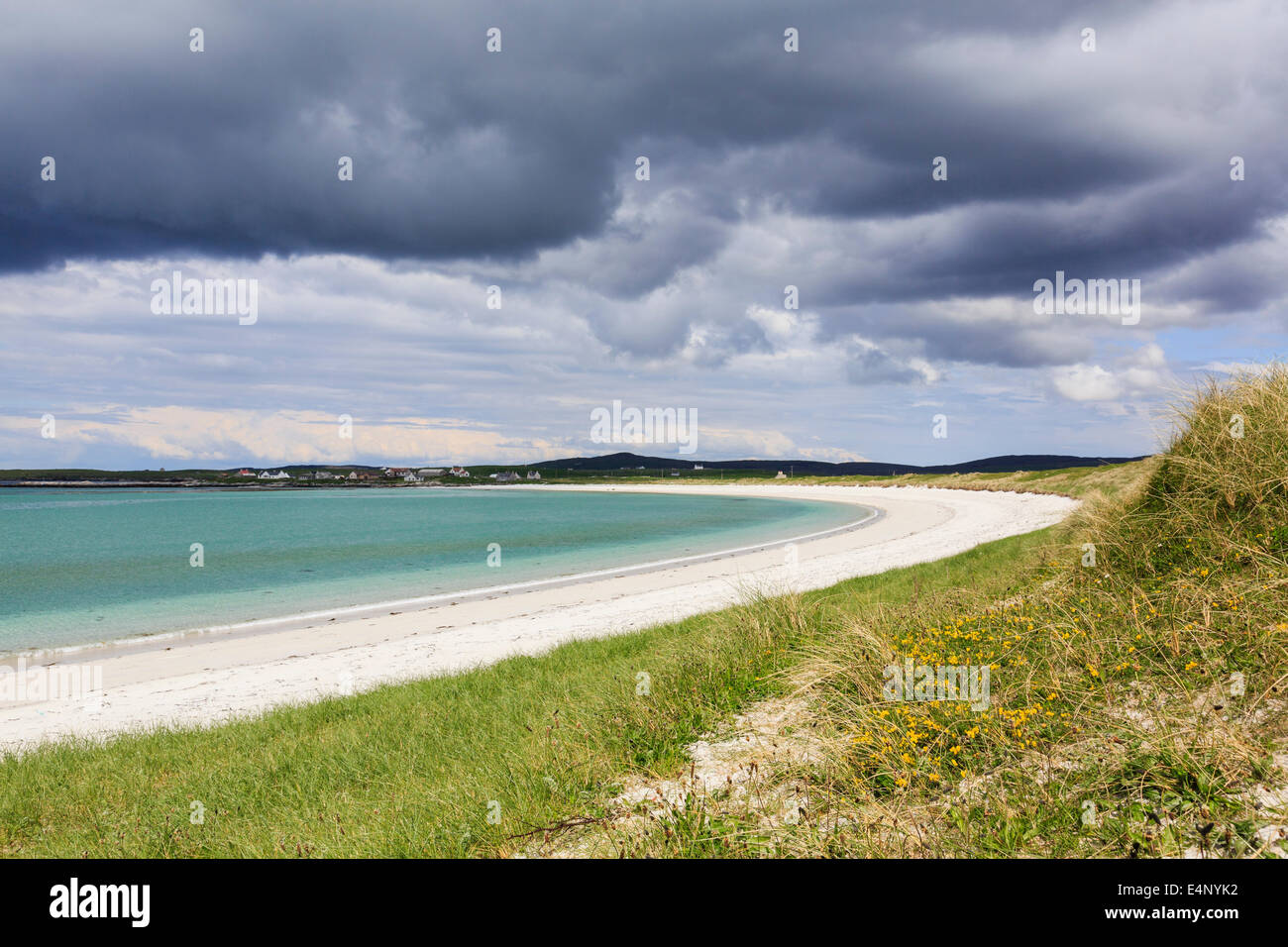 Empty Traigh nam Faoghailean beach with dark overcast sky at Balranald RSPB Nature Reserve North Uist Outer Hebrides - Stock Image