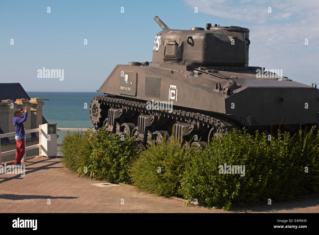 Boy taking photo of French 2nd DB Sherman tank Berry Au Bac on display at Arromanches, Normandy, France in July - Stock Image