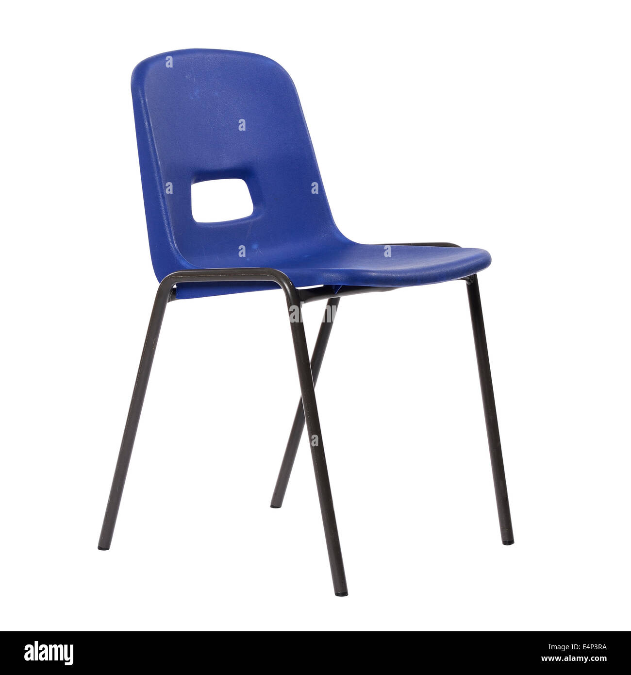 Blue plastic stacking school chair - Stock Image
