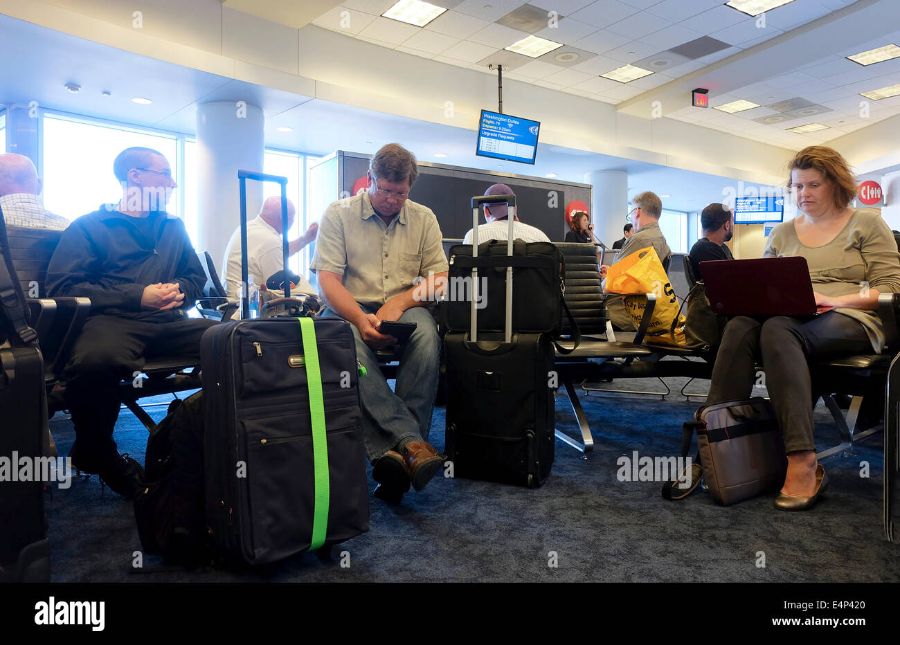 Pssengers waiting for a flight at a departure gate at Los Angeles International Airport, California, USA - Stock Image