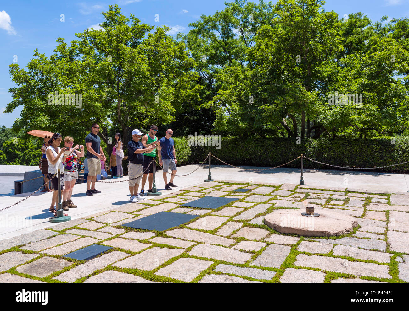 Tourists taking photographs of Eternal Flame at John F Kennedy grave site, Arlington National Cemetery, Arlington, - Stock Image
