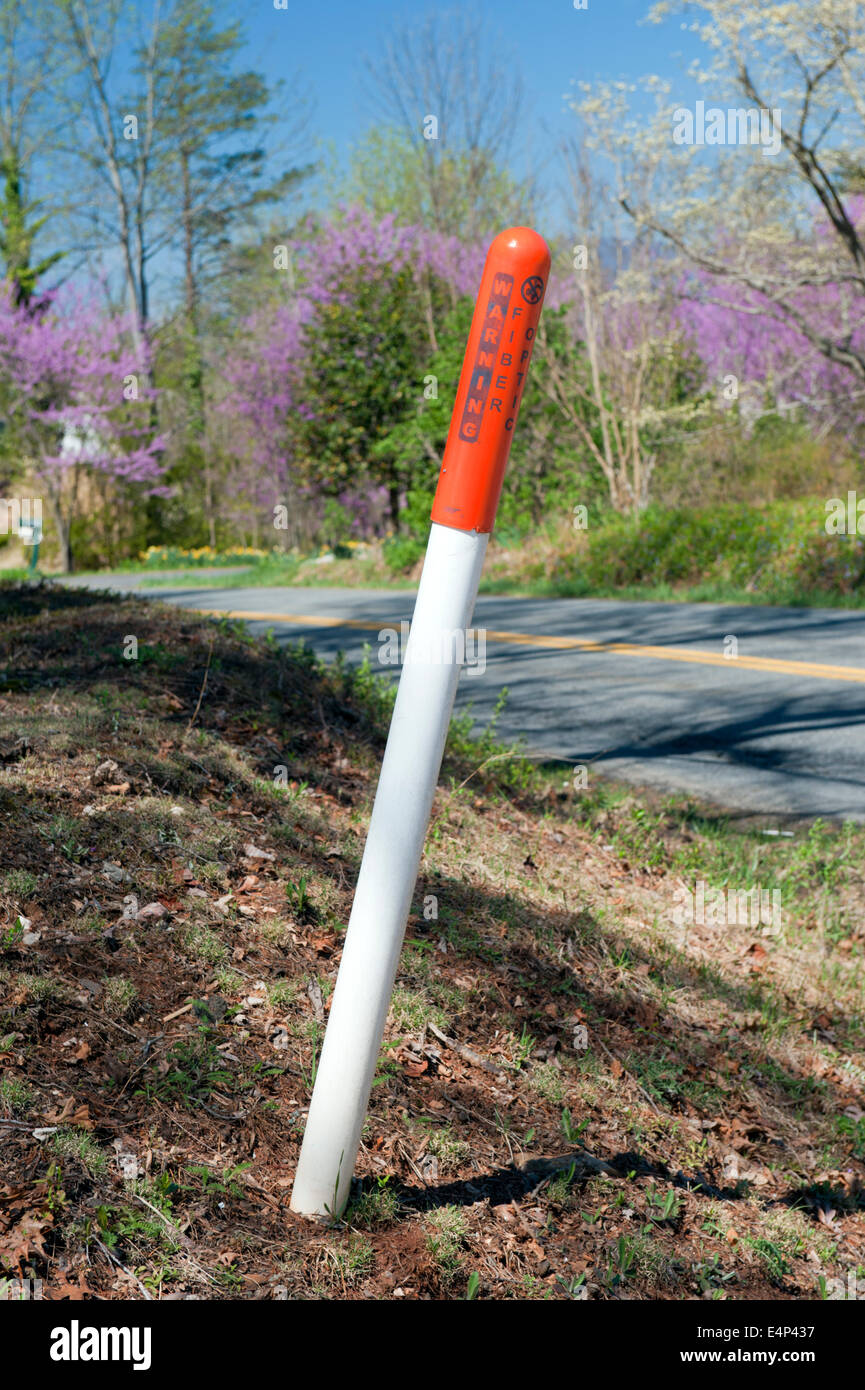 Warning post for underground fiber optic cables in Virginia, USA. - Stock Image