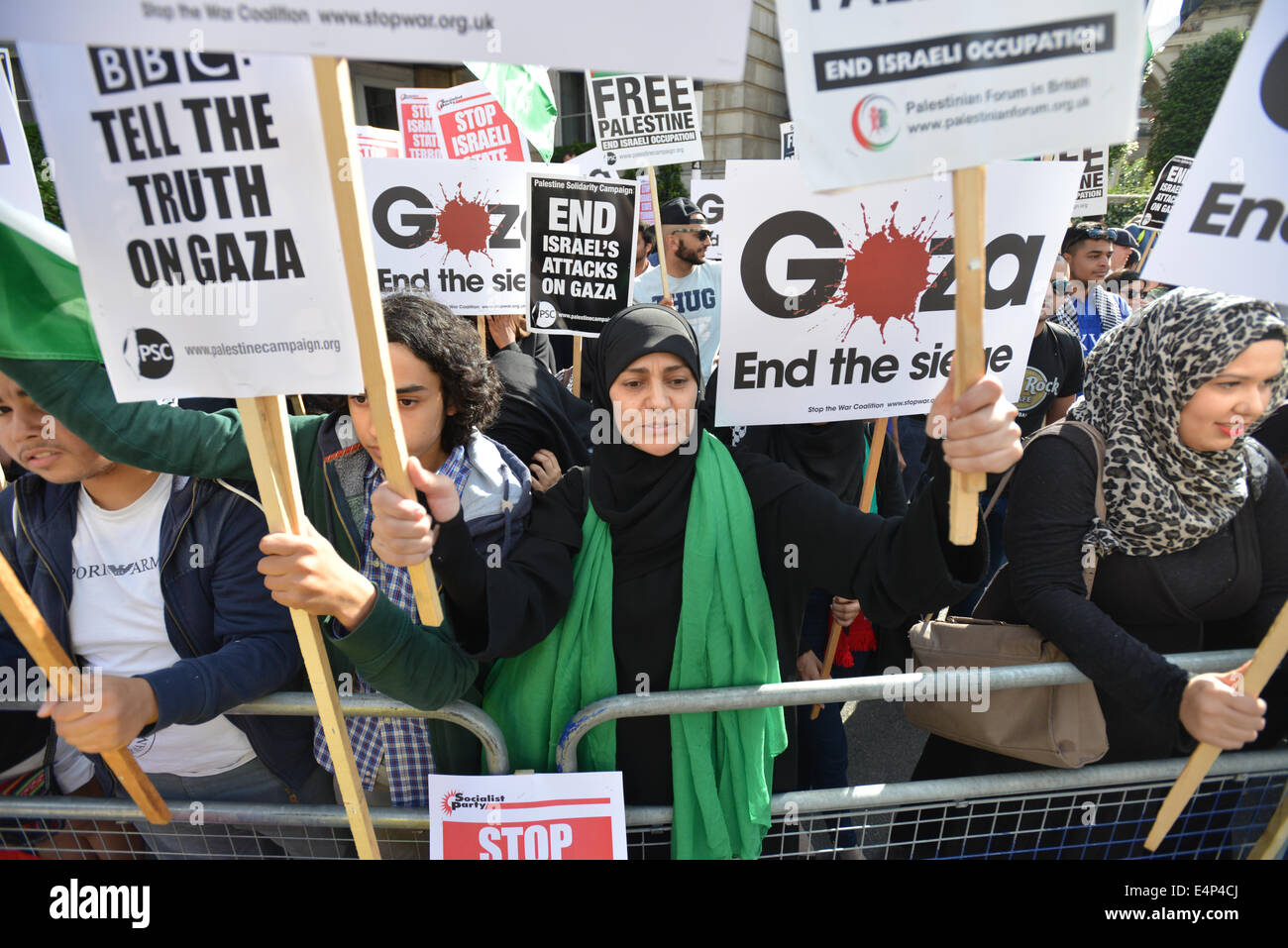 Langham Place, London, UK. 15th July 2014. Pro Palestinian supporters stage a mass protest outside the BBC headquarters - Stock Image