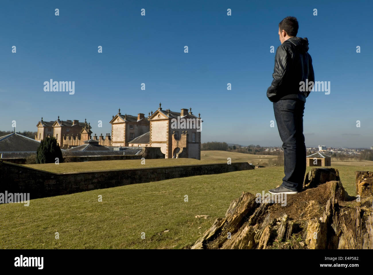 You man surveys the scene looking out over Chatelherault Country Park. - Stock Image