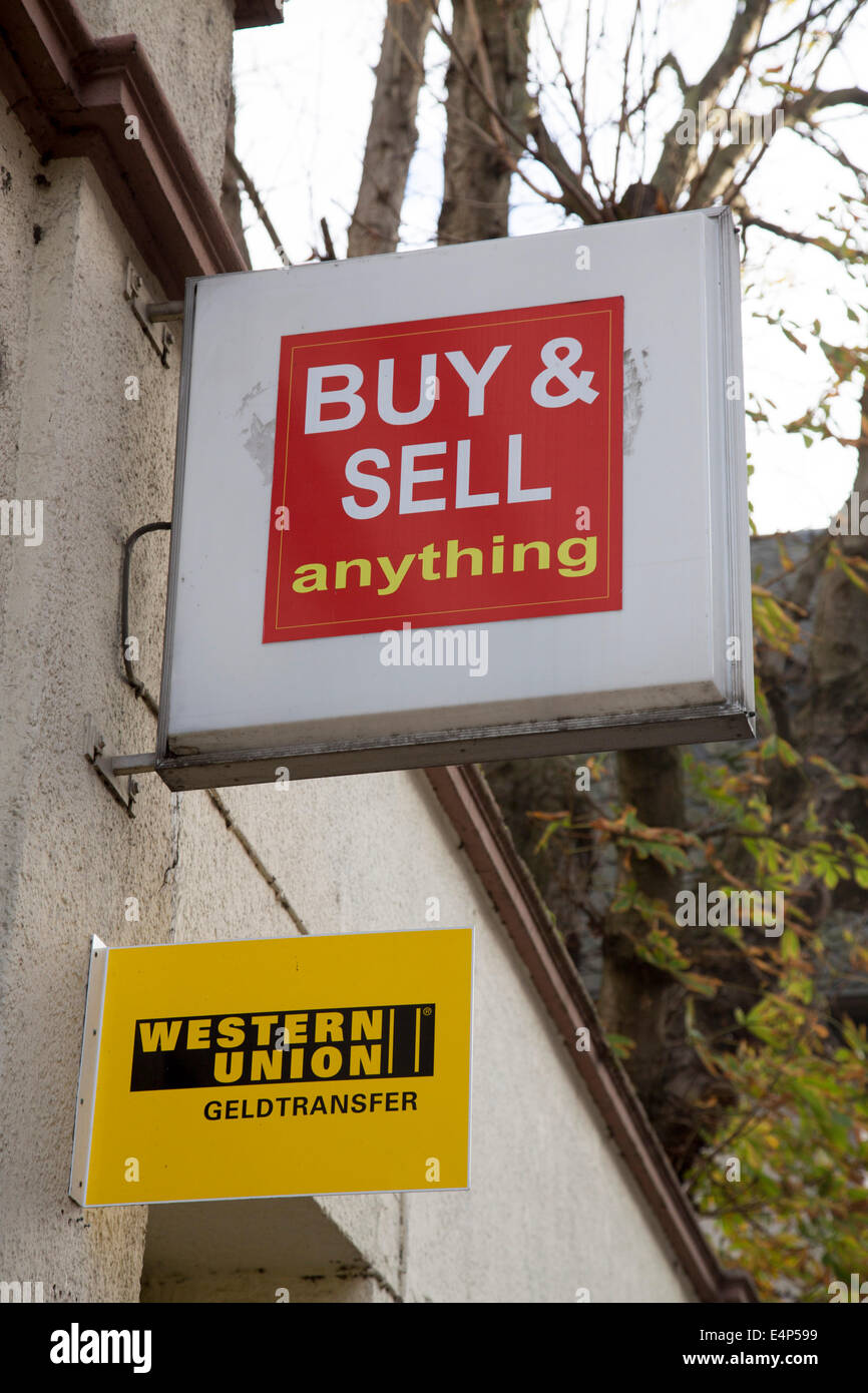 Signboard of a shop where you can buy and sell anything, Western Union money transfer, - Stock Image