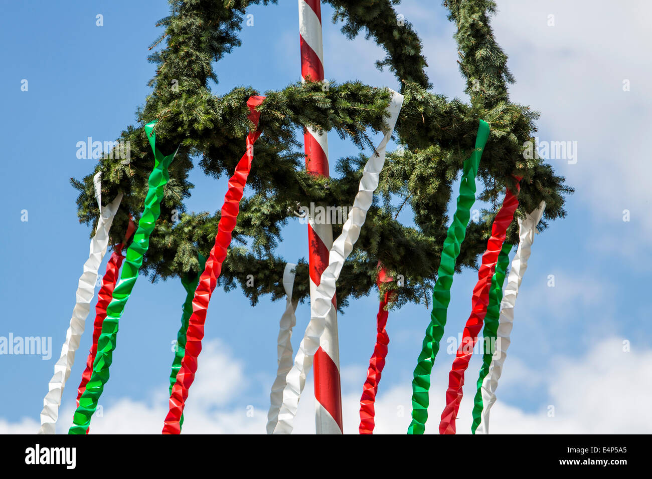 Maypole, erected by the local volunteer fire department, - Stock Image