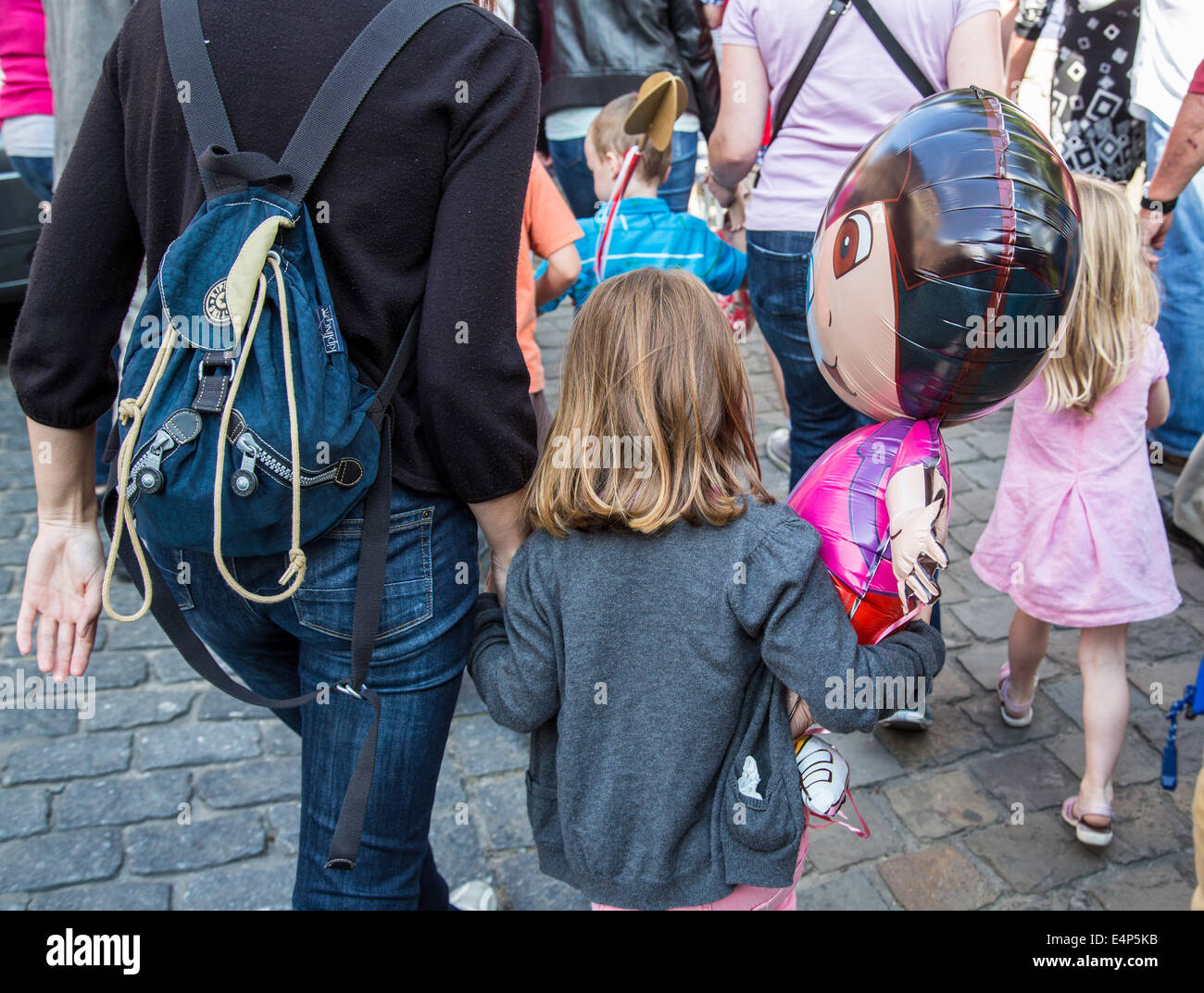 Mother and daughter filled with a gas balloon - Stock Image