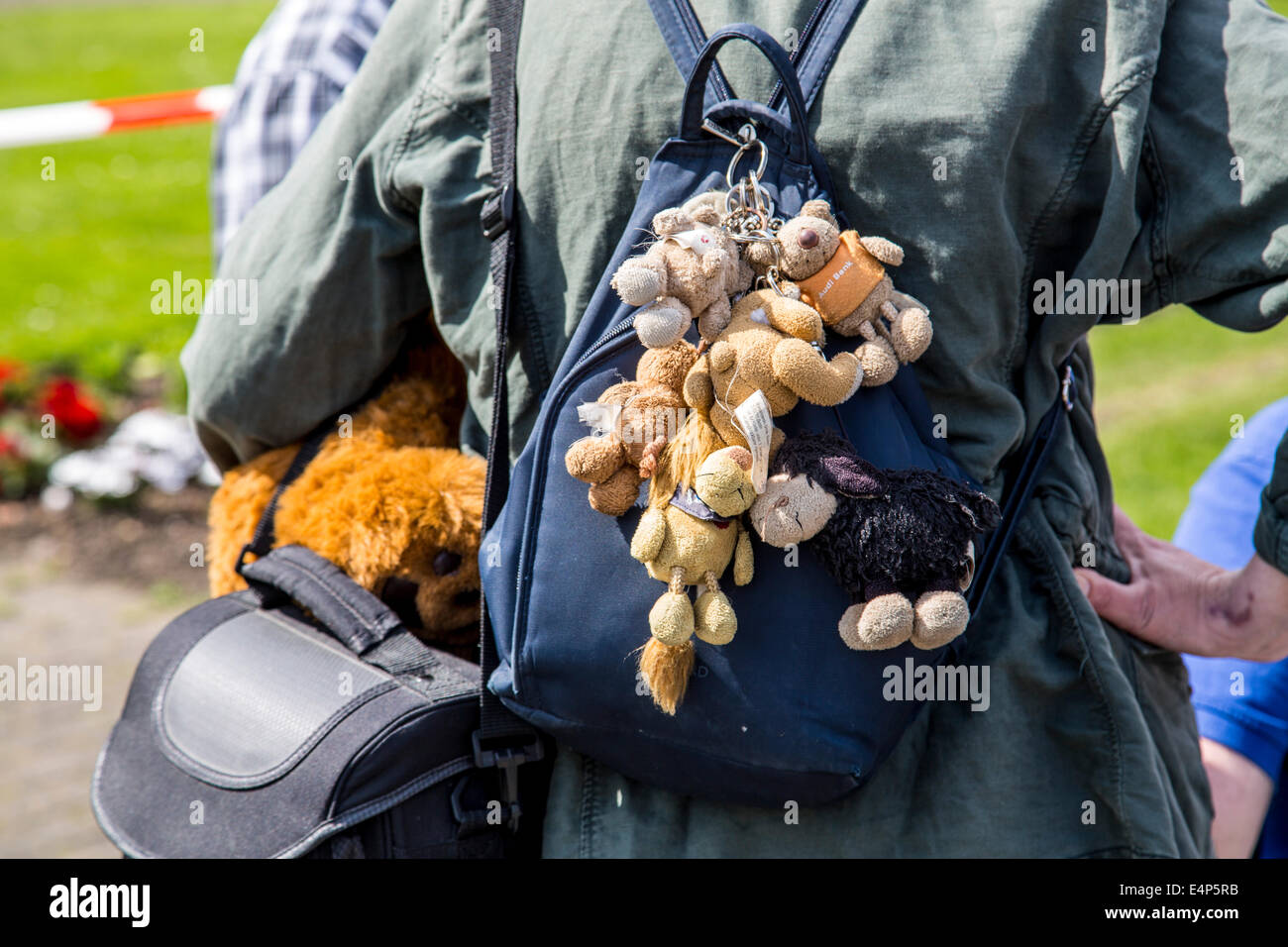 Woman with many soft toy keychain on a backpack - Stock Image
