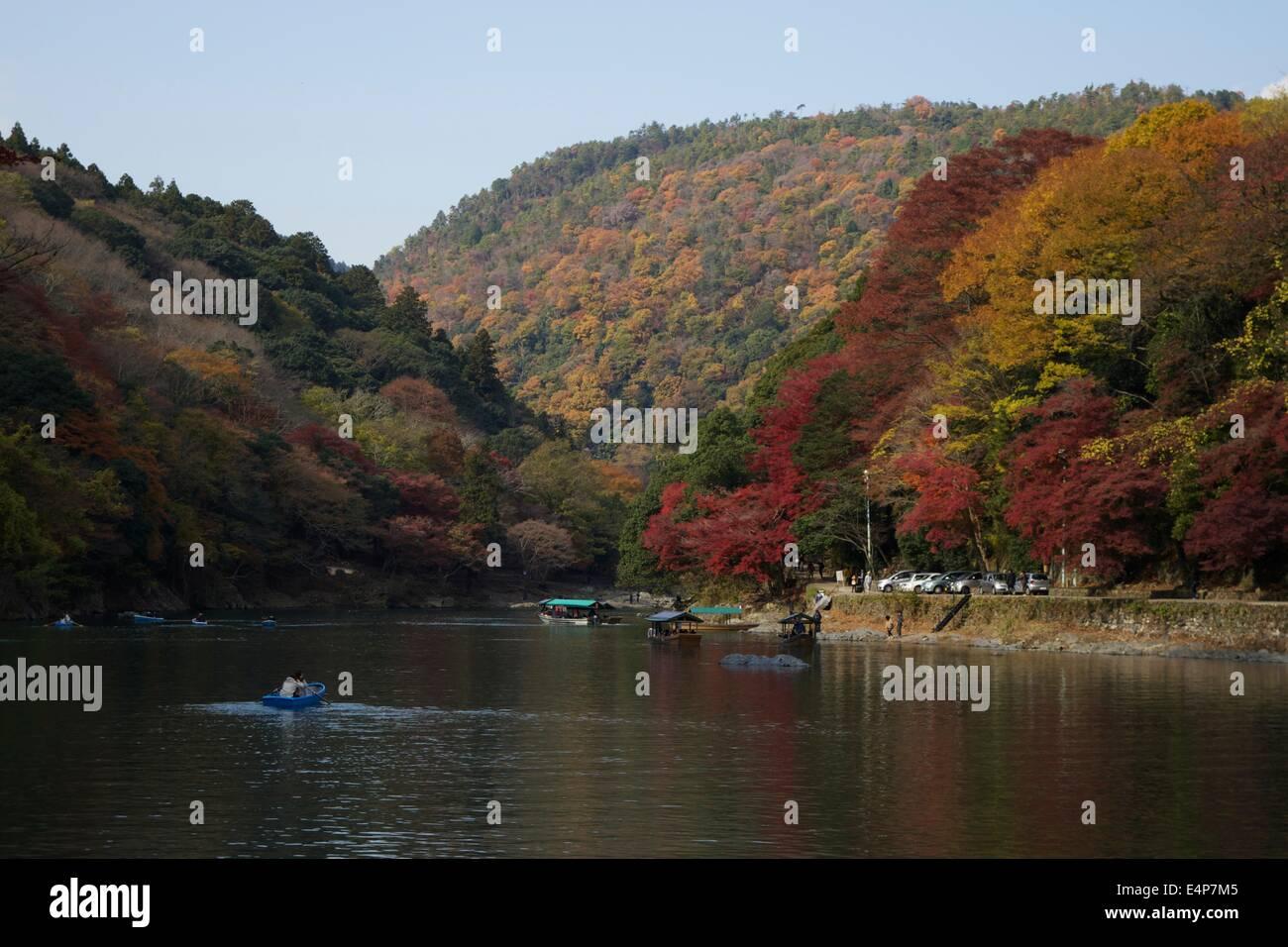 Fall Colors Along Hozu River in Arashiyama, Kyoto, Japan - Stock Image