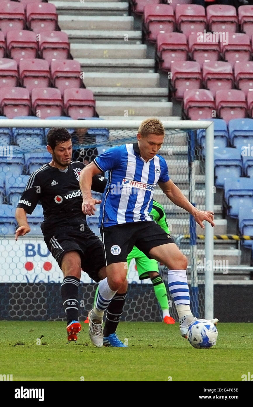 Wigan, UK. 15th July, 2014. Pre-season football friendly. Wigan versus Besiktas. Martyn Waghorn in possession of - Stock Image