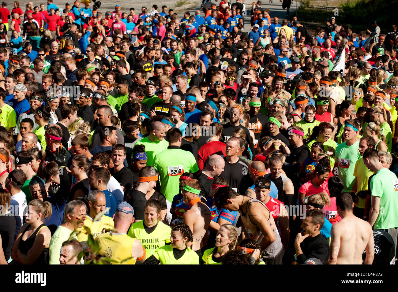 Crowds at the start of the Whistler Vancouver Tough Mudder event. - Stock Image