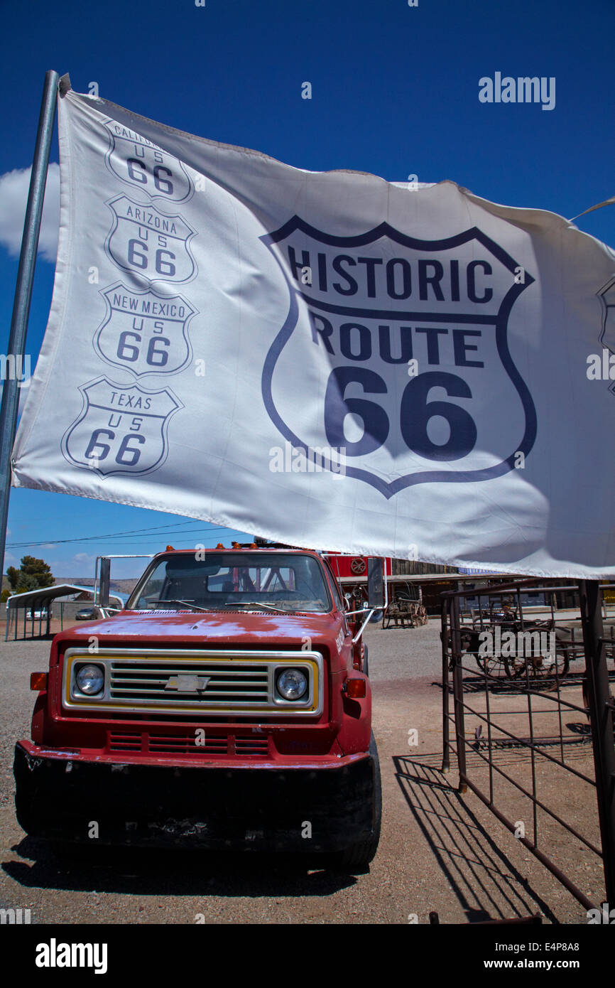 Chevrolet tow truck and giant Route 66 flag, Seligman, Historic U.S. Route 66, Arizona, USA Stock Photo