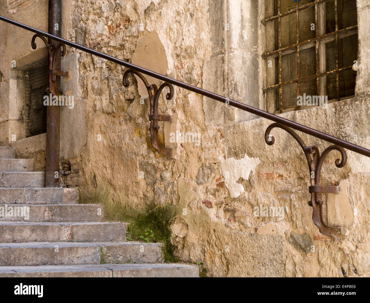 Iron Handrails on Girona's Stepped streets. Detail of a handrail on Girona's steep streets. - Stock Image