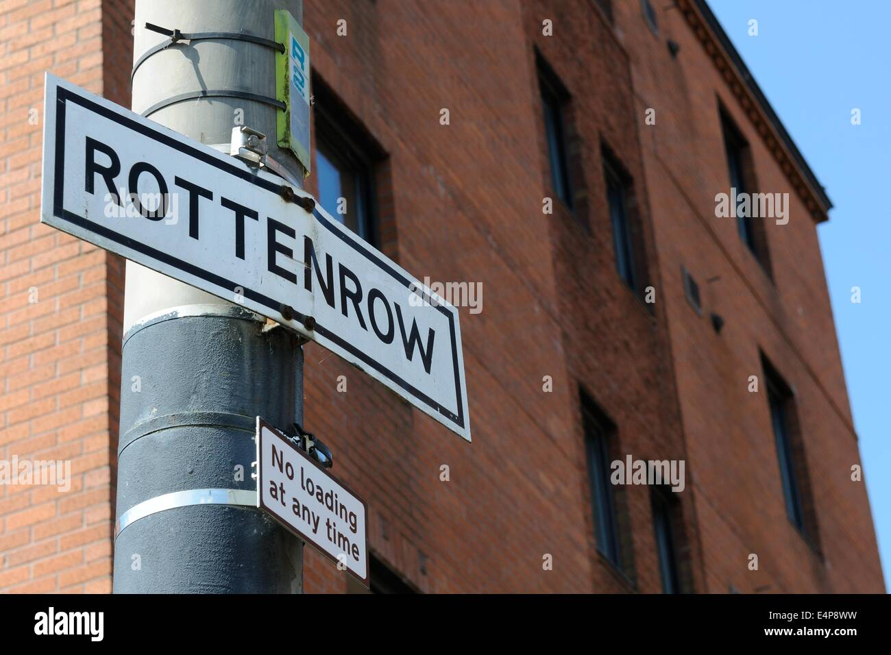Signpost in Glasgow, Scotland showing Rottenrow the site of Glasgow's now closed old maternity hospital. Stock Photo