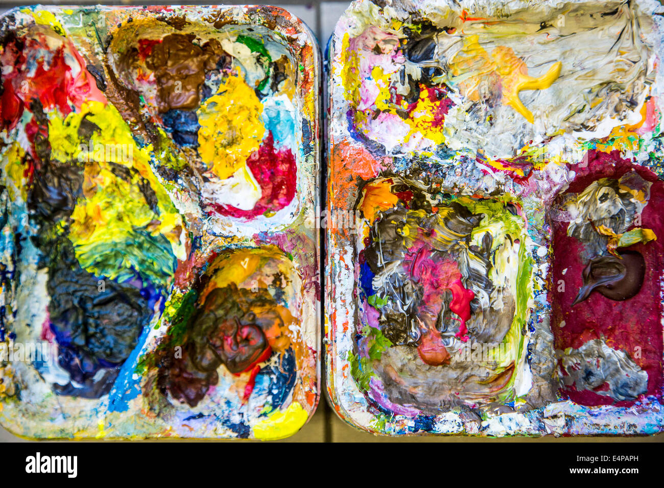 Color palette, container for mixing of colors in a painting school, painting, - Stock Image