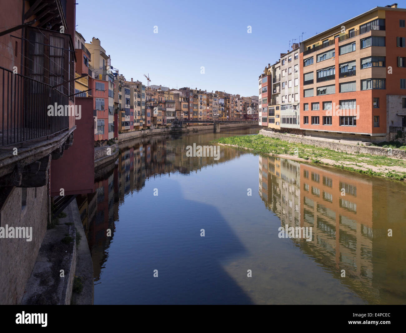 Houses along the Onyar River in Girona. Colourful houses line the canalized river in the centre of the City. Stock Photo
