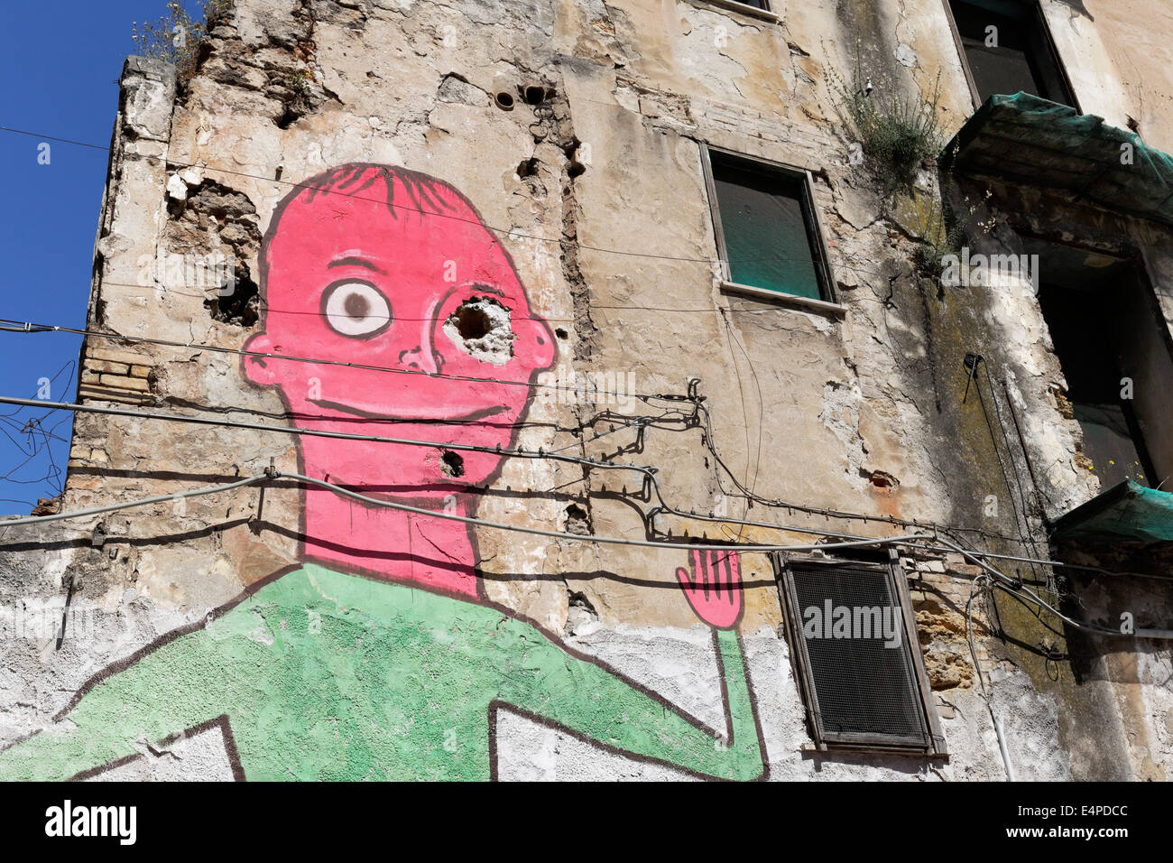 Figure with a red head, mural on a run-down house in the historic centre, Palermo, Province of Palermo, Sicily, - Stock Image
