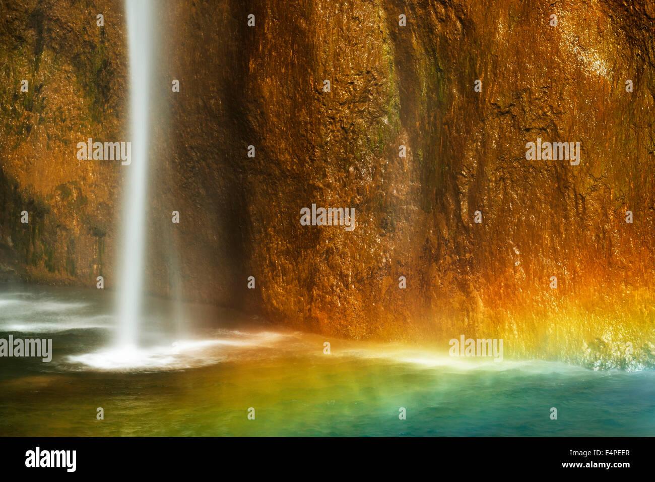 Waterfall with a rainbow, Plitvice Lakes National Park, Plitvice Jezera, Lika-Senj, Croatia - Stock Image