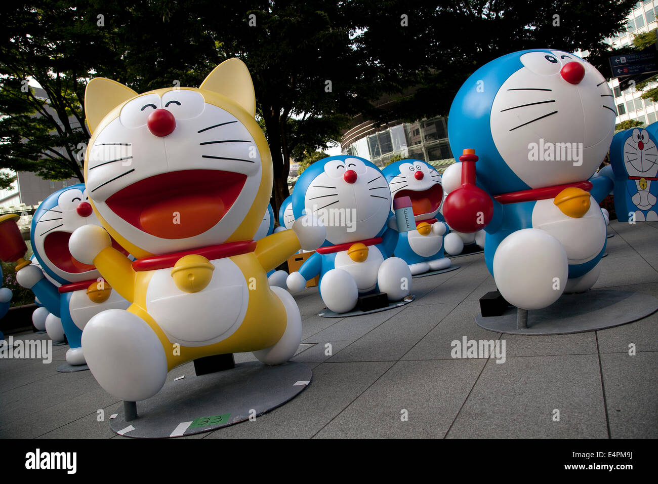 The statues of the japanese manga series doraemon at roppongi hills on july 16 2014 sixty six different statues of popular japanese cartoon character