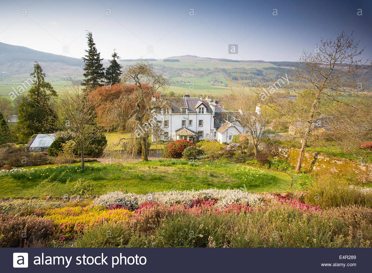 Cluny House Gardens with the house itself visible, near Aberfeldy, Perthshire, Scotland. - Stock Image