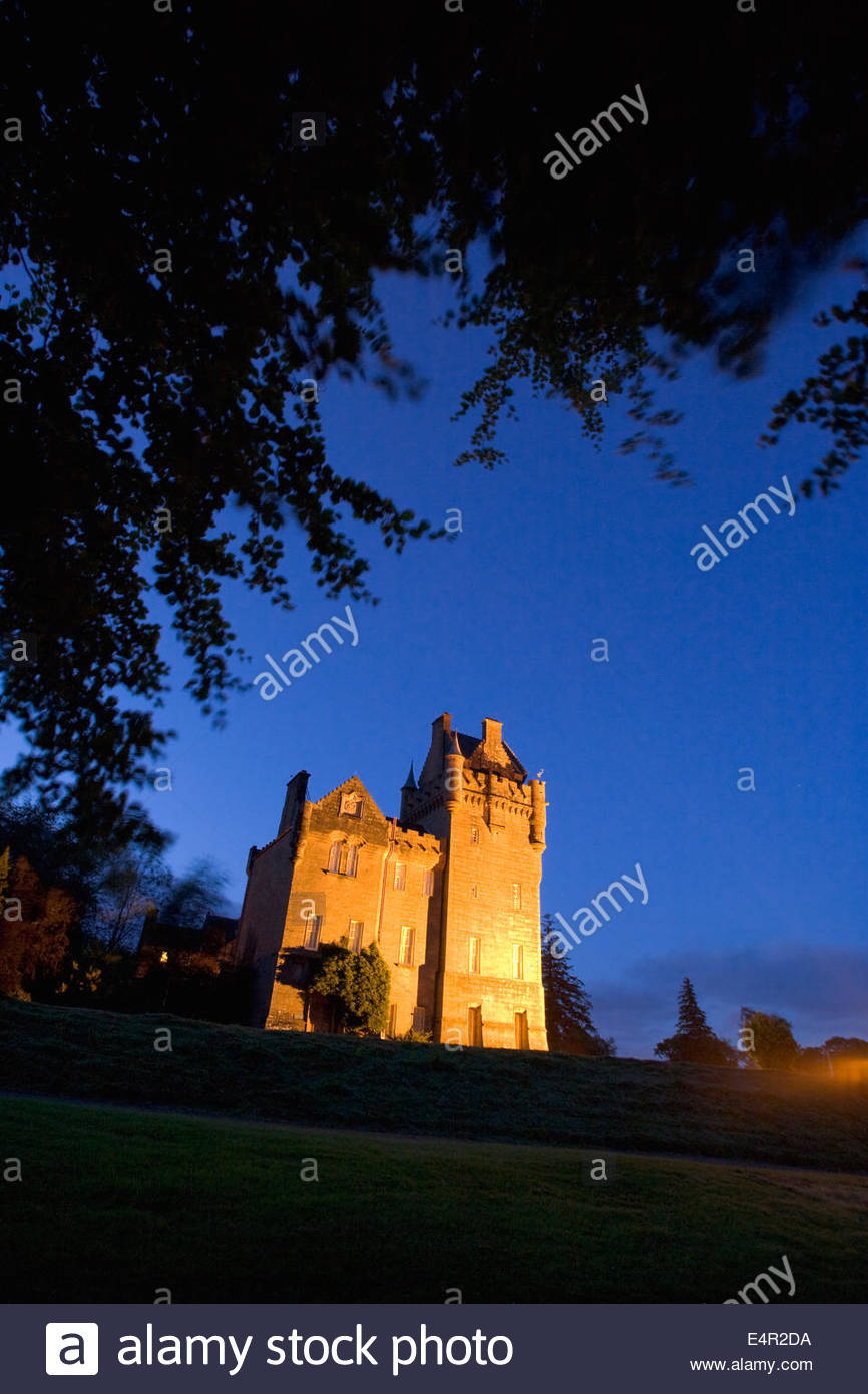 Brodick Castle photographed at dusk on the Isle of Arran, North Ayrshire, Scotland - Stock Image