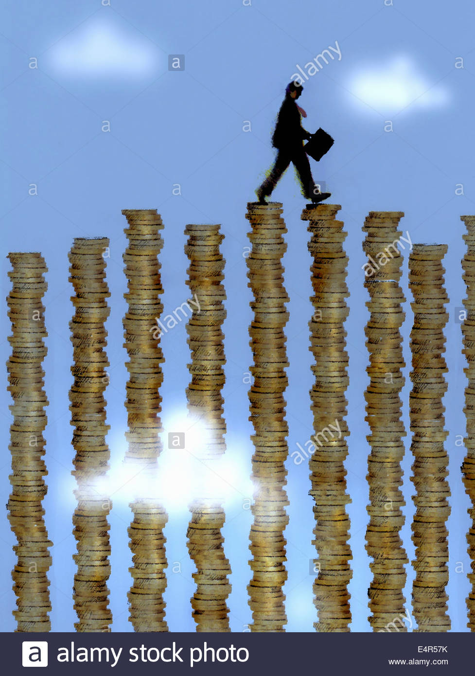 Businessman walking across stacks of coins forming money bar chart - Stock Image