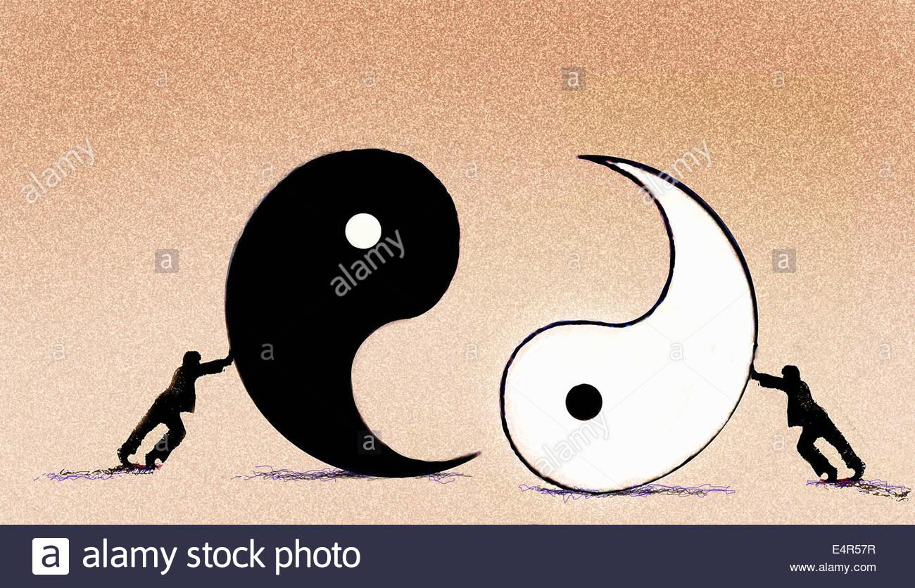 Businessmen pushing yin and yang symbols together - Stock Image