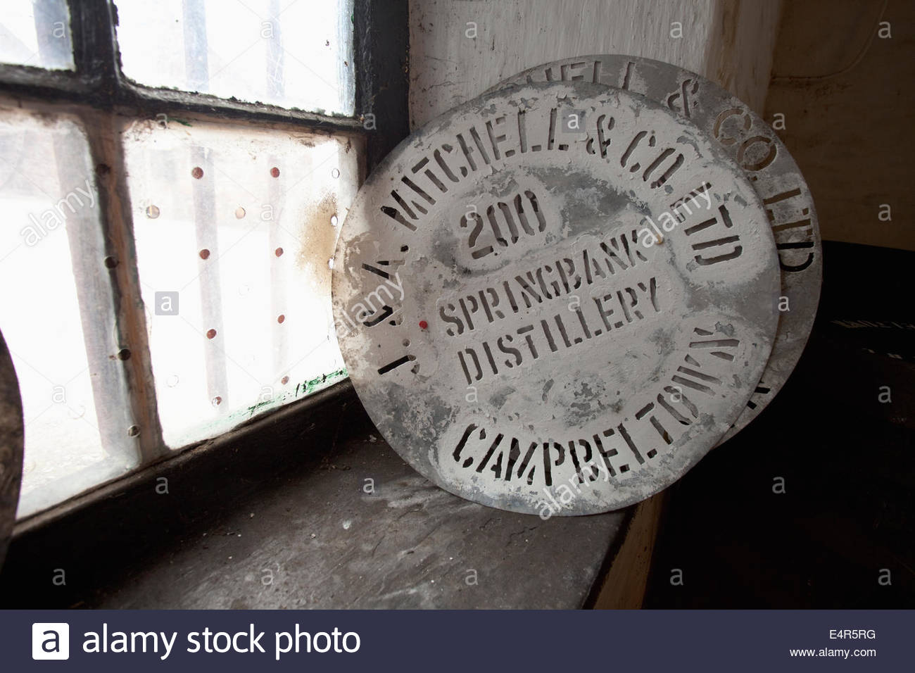 Stencils for labelling whisky casks on a windowsill at the Springbank Distillery, Campbeltown, Kintyre, Argyll, - Stock Image