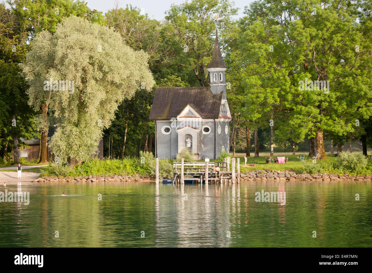 Lakeside Chapel of the Holy Cross on the island Herreninsel in lake Chiemsee, Chiemgau, Bavaria, Germany, Europe - Stock Image
