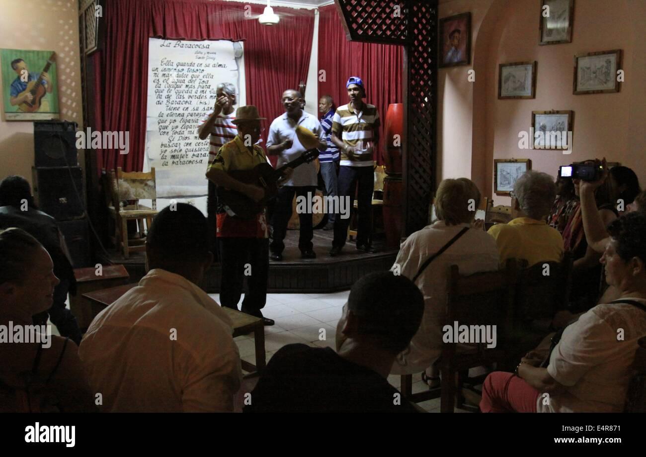 Nightlife in Baracoa, Cuba, 13 April 2014. The tiny bar 'Vasa de la Trova' offers tourists life music by - Stock Image
