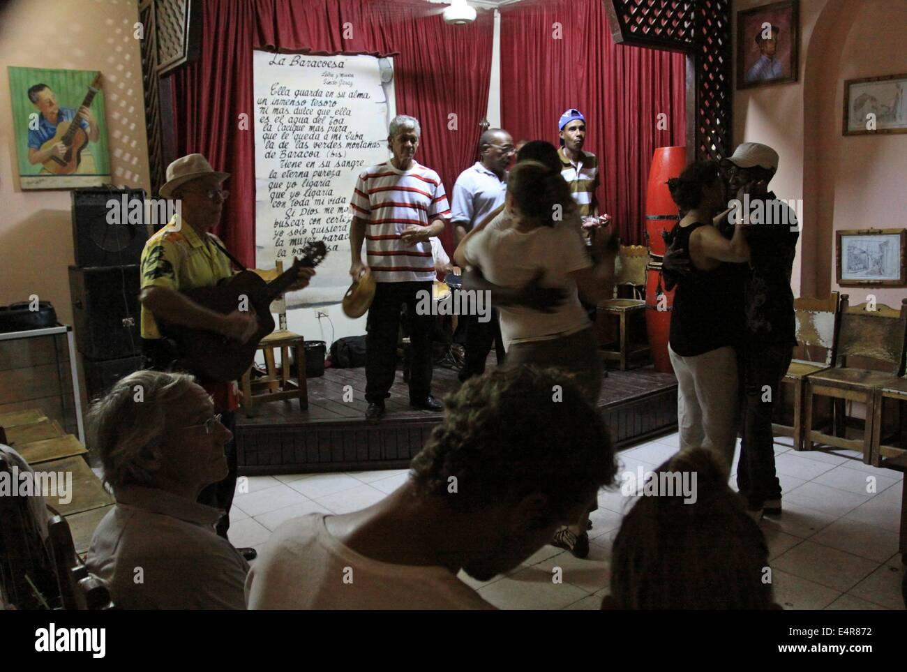 Nightlife in Baracoa, Cuba, 13 April 2014. The tiny bar 'Casa de la Trova' offers tourists life music by - Stock Image