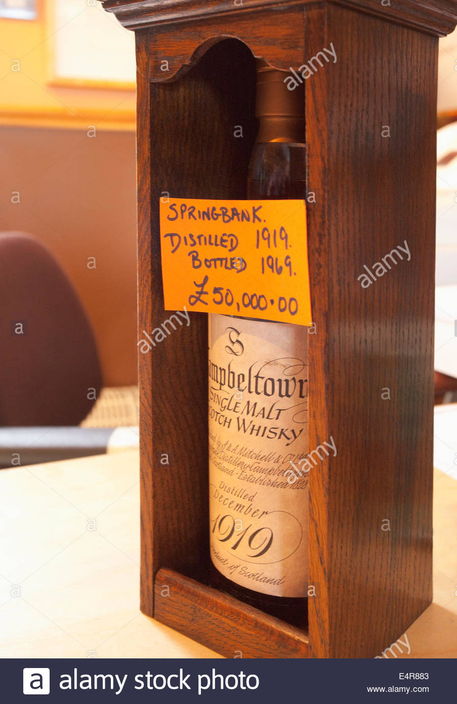 A bottle of 1919 single malt whisky valued at £50,000 at the shop at the Springbank Distillery, Campbeltown, - Stock Image