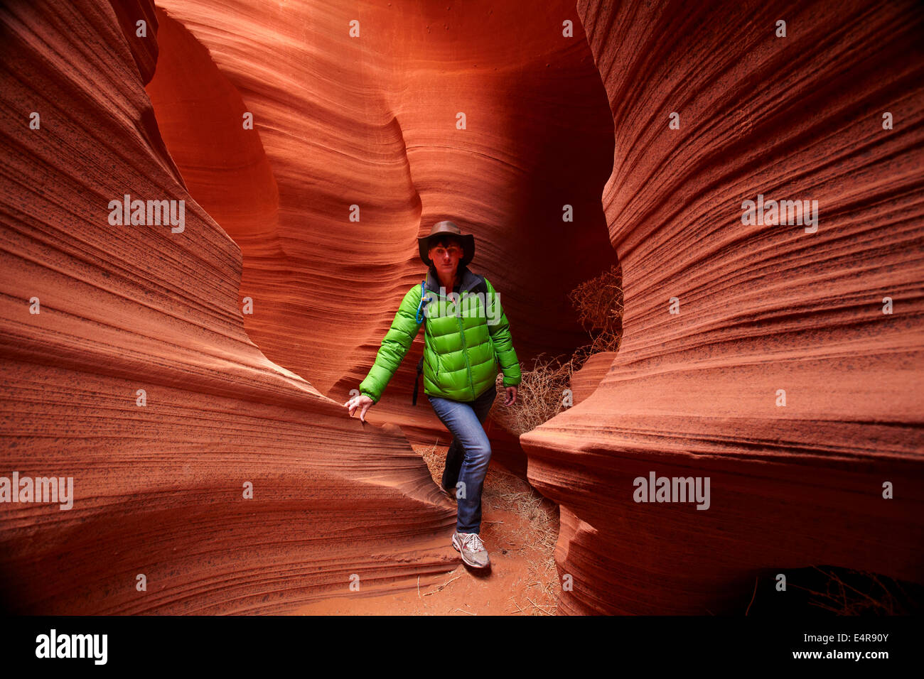 Tourist and eroded sandstone formations in Rattlesnake Canyon, near Page, Navajo Nation, Arizona, USA Stock Photo