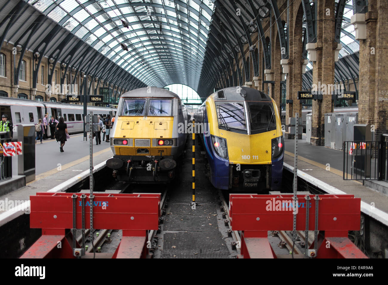 Trains ready to depart King's Cross Railway Station in London, UK. - Stock Image