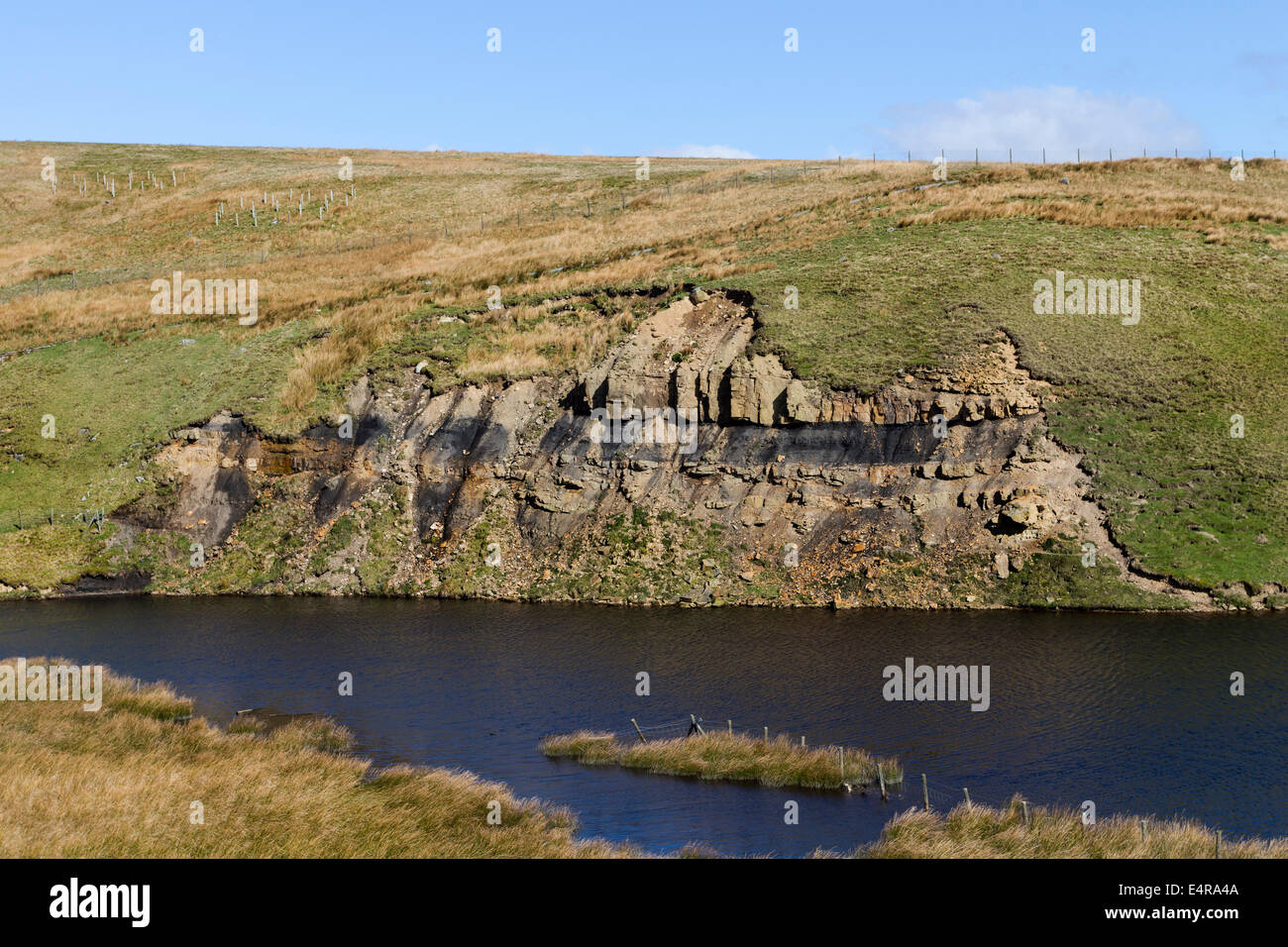 Sedimentay Rocks with Shale Band Next to a Water Supply North Pennines UK - Stock Image