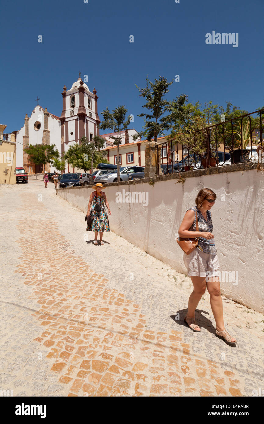 People walking down from Silves Cathedral ( Se Catedral ), Silves, Algarve, Portugal Europe - Stock Image