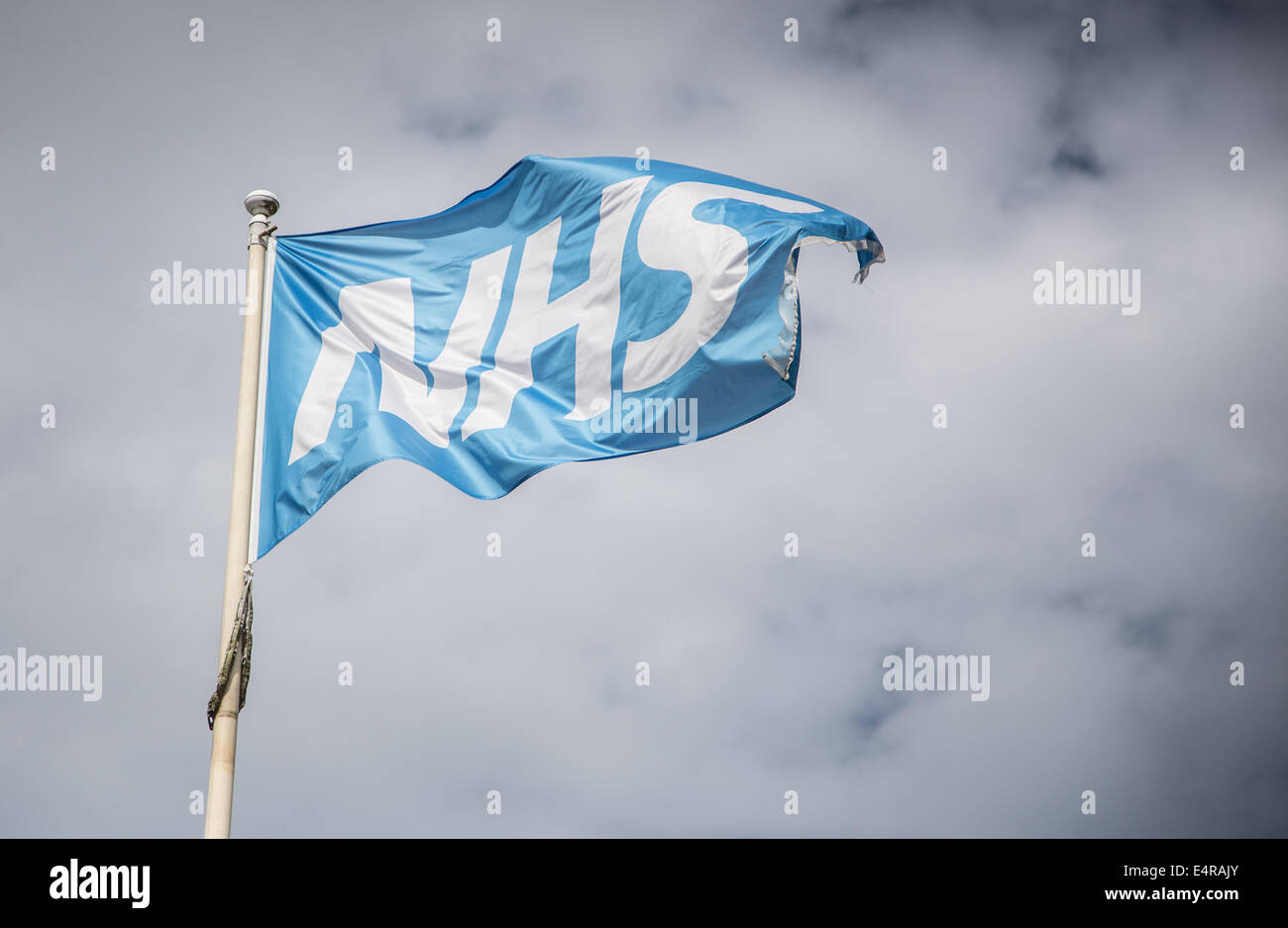 NHS flag flying on a flag pole in the wind - Stock Image