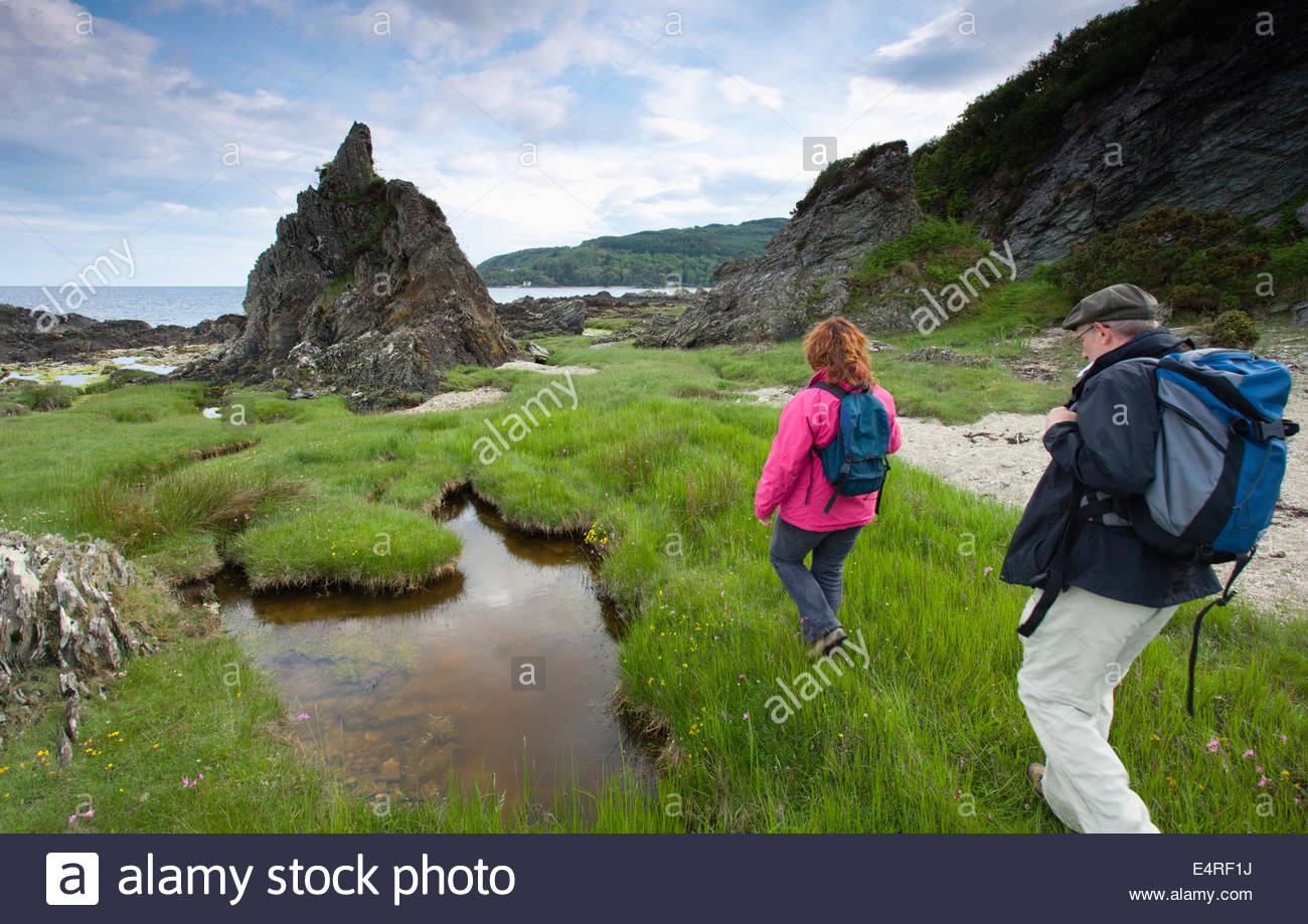 A couple of walkers on the Kintyre Way - a long distance footpath, near Carradale, Kintyre, Argyl, Scotland. - Stock Image