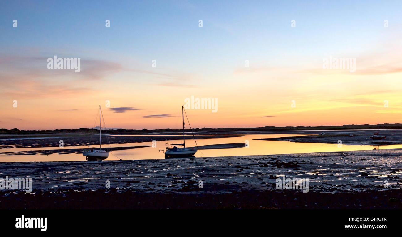 Sunset over the River Esk estuary at Ravenglass on the Cumbrian coast. - Stock Image