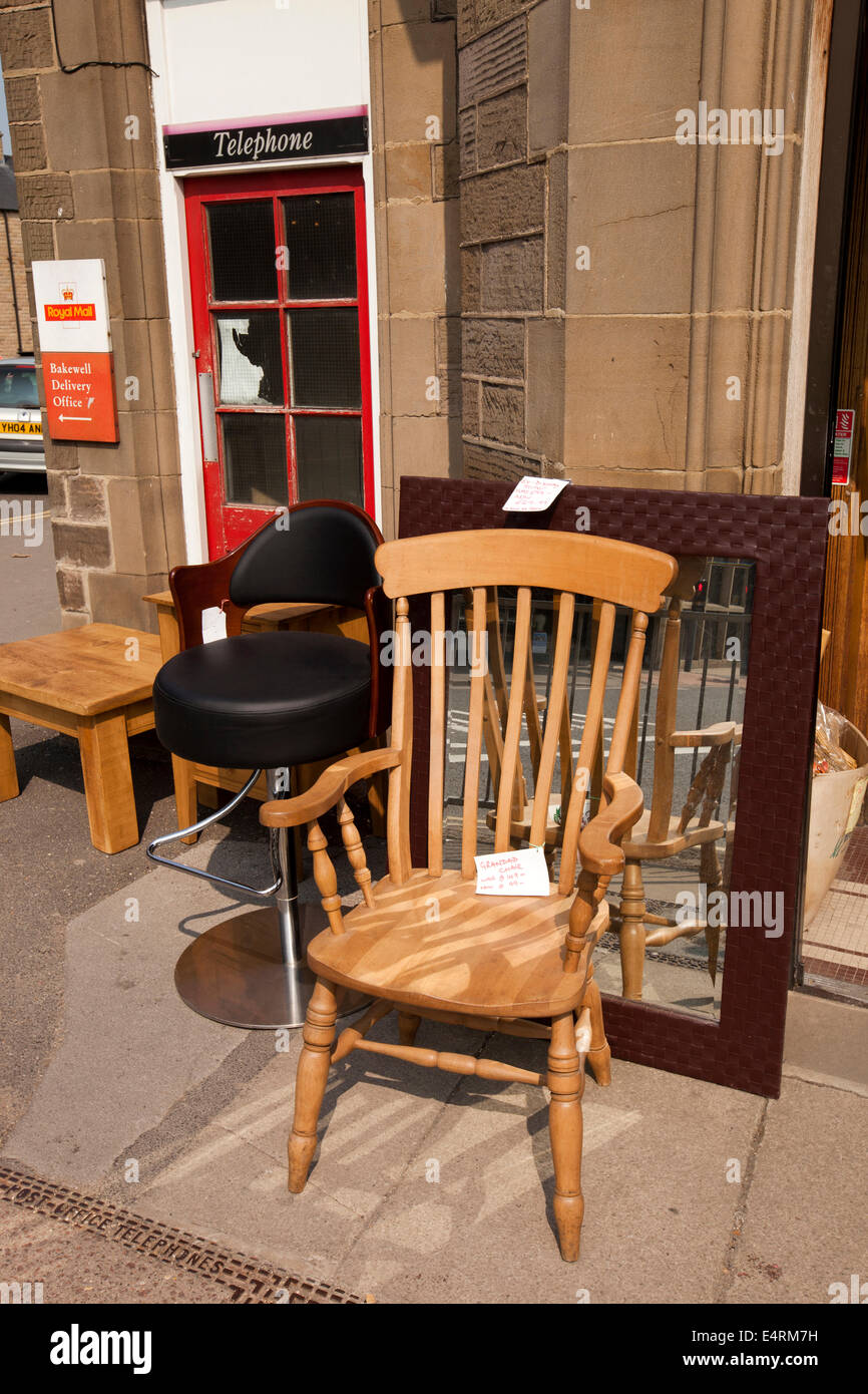 UK, Derbyshire, Peak District, Bakewell, Bridge Street, furniture shop stock outside old Post Office - Stock Image