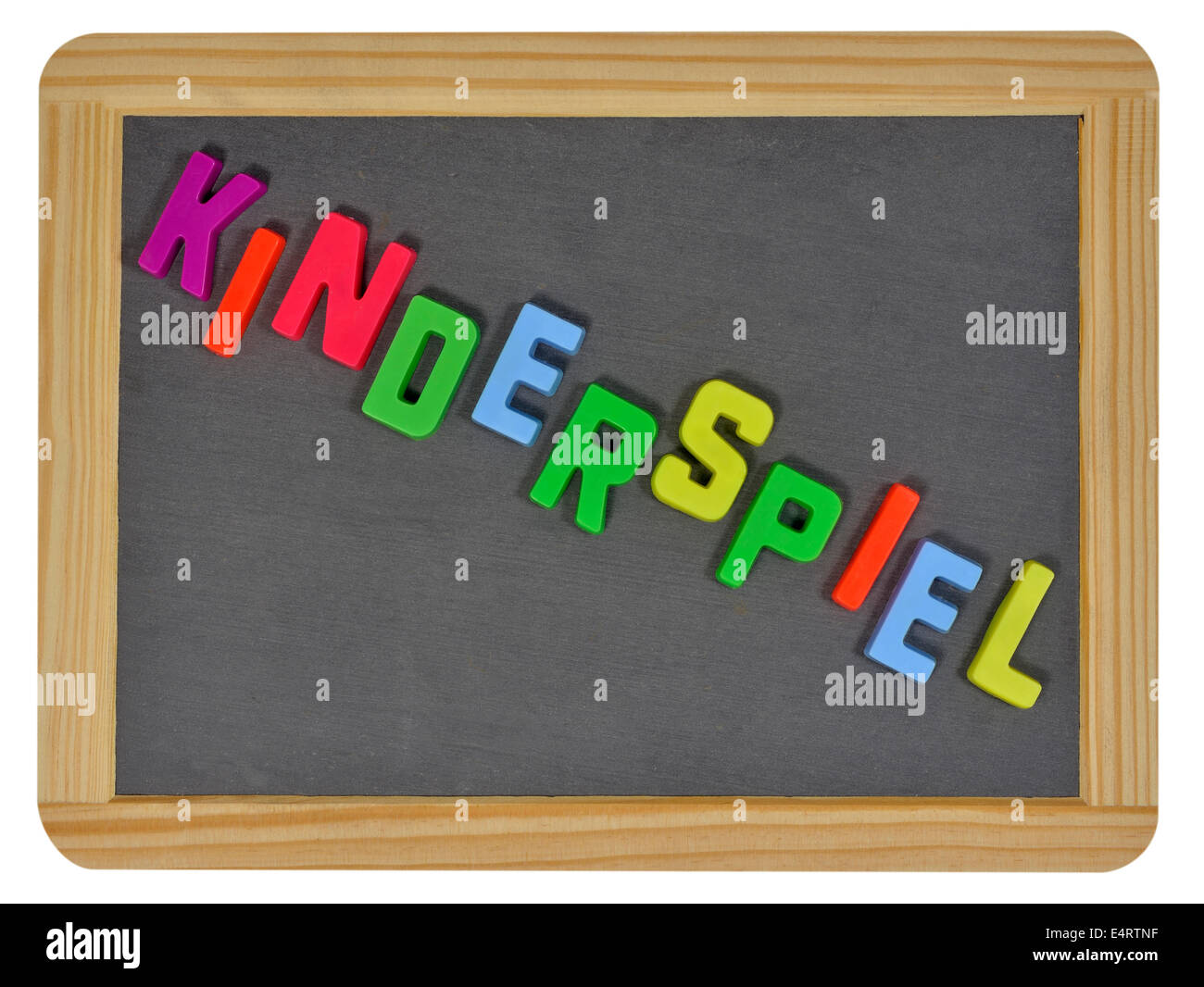 Kinderspiel in colored letters written on traditional slate - Stock Image