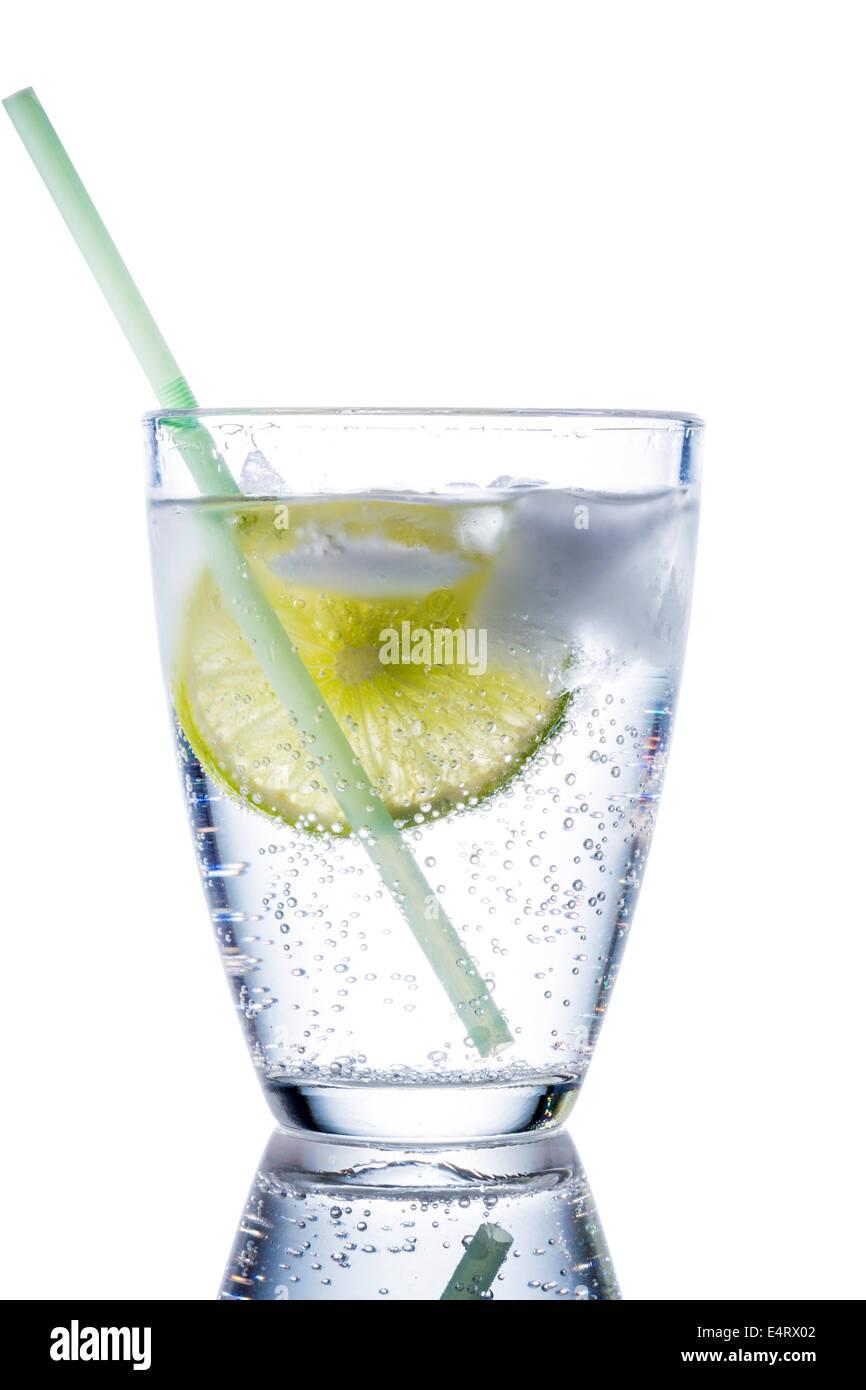 A glass with fresh drinking water and a lime. Mineral water as a Durstloescher., Ein Glas mit frischem Trinkwasser Stock Photo