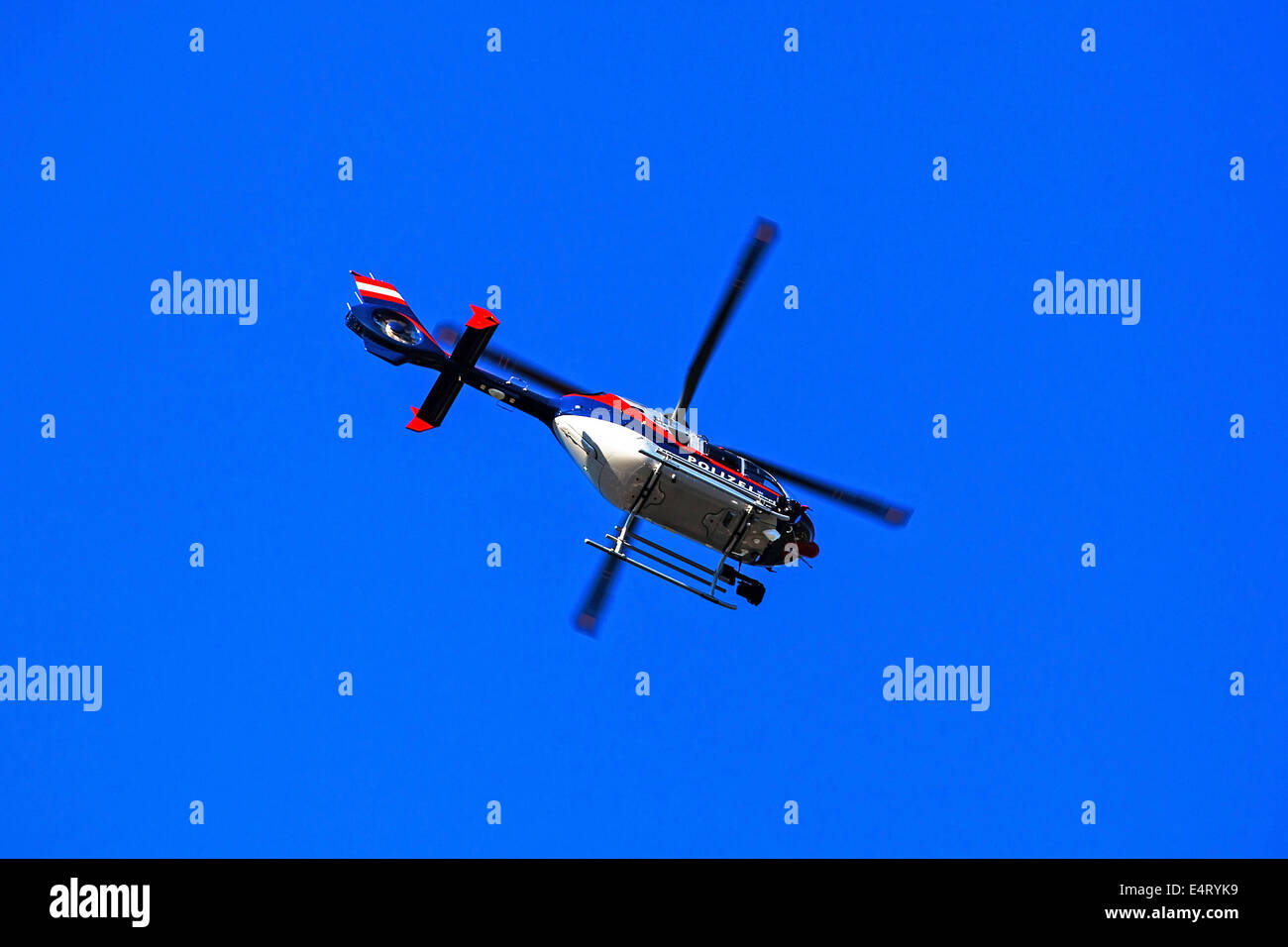 Helicopter in the blue sky, symbolic photo for supervision and rescue, Helikopter am blauen Himmel, Symbolfoto fuer - Stock Image