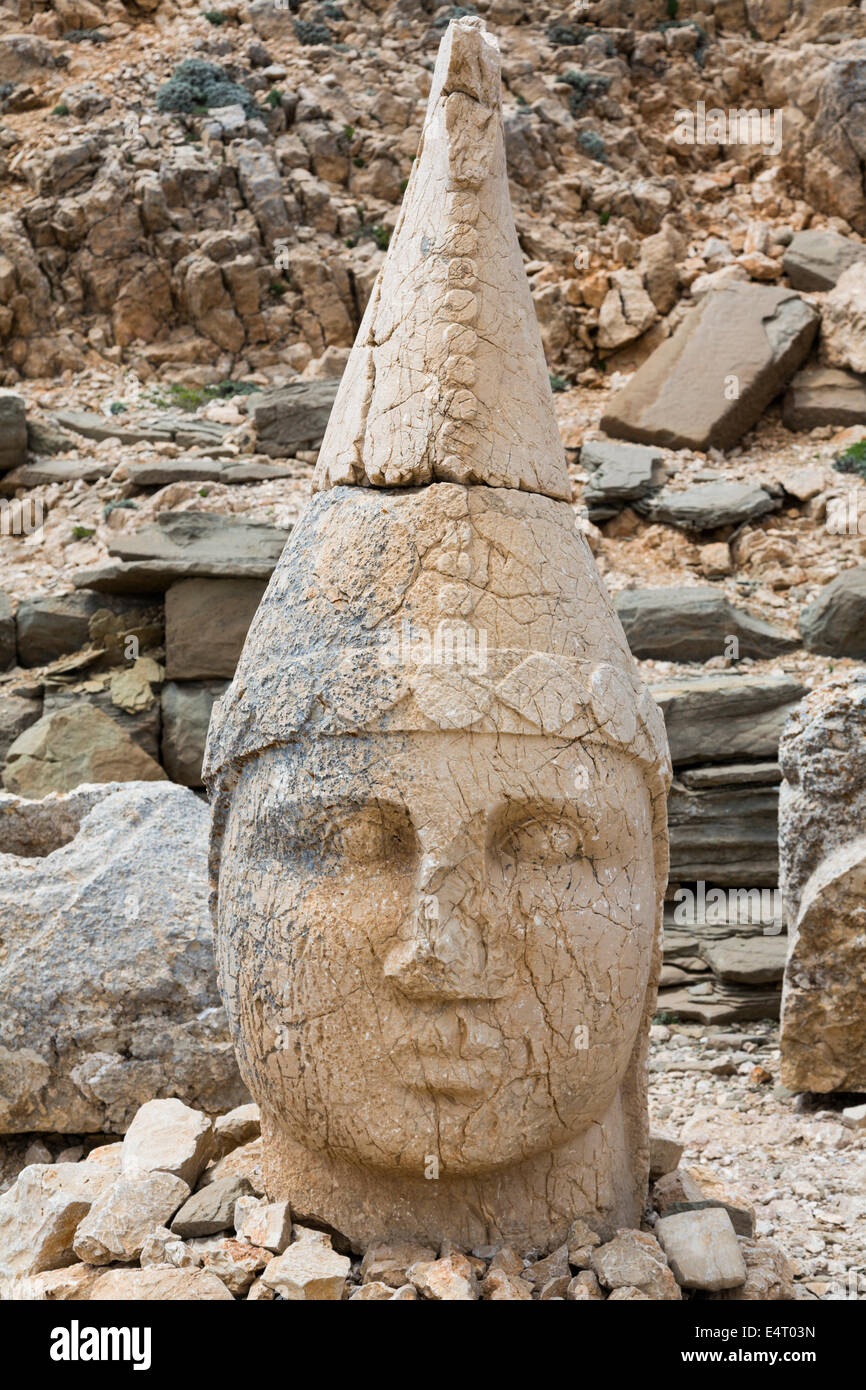 head of statue of Apollo Mithras Helios Hermes, east terrace, Nemrut or Nemrud Dagh, Anatolia, Turkey - Stock Image