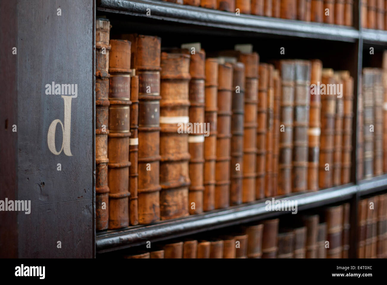Book shelves with historic books at Trinity College Library 'The Long Room', Dublin, Ireland - Stock Image