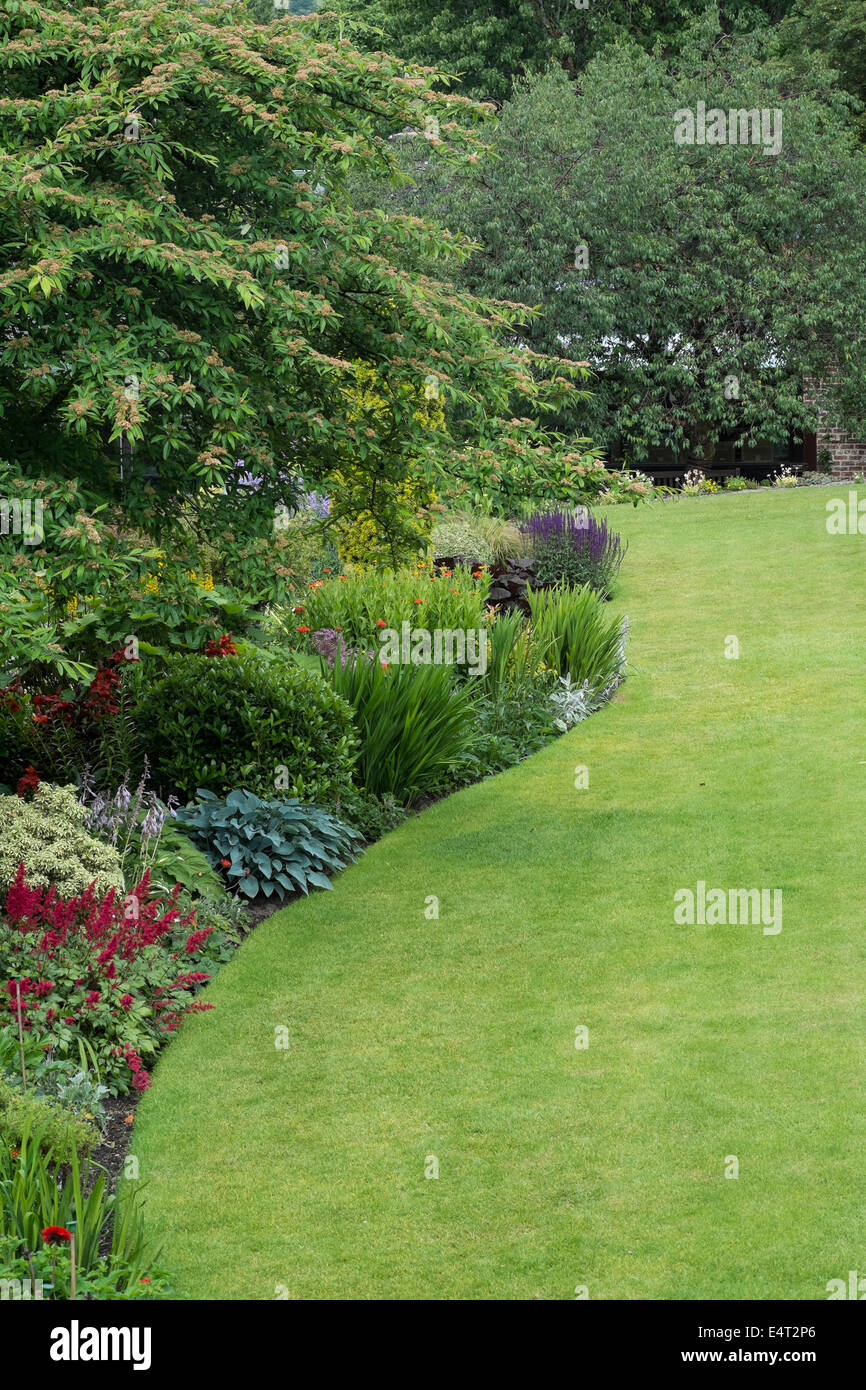 The lawn and gardens at Holehird in the Lake District - Stock Image
