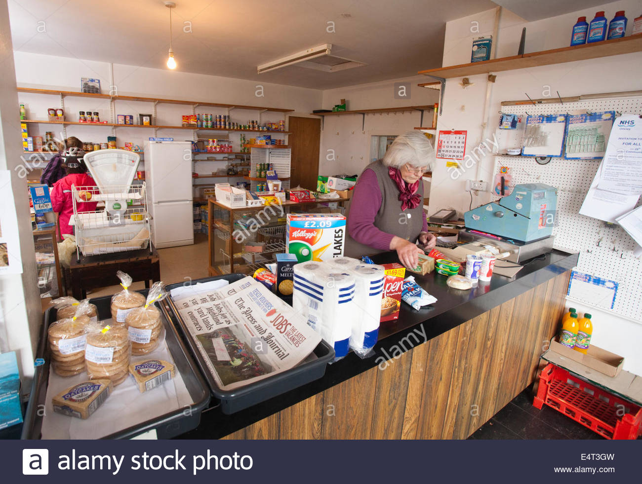 Helen Swanney in the Airfield Goods and Services Shop,  North Ronaldsay, Orkney, Scotland. - Stock Image